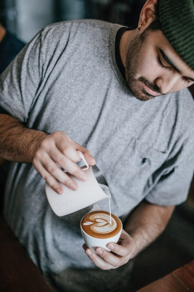 guy pouring detroit bold coffee