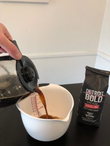 Pour Detroit bold coffee into container